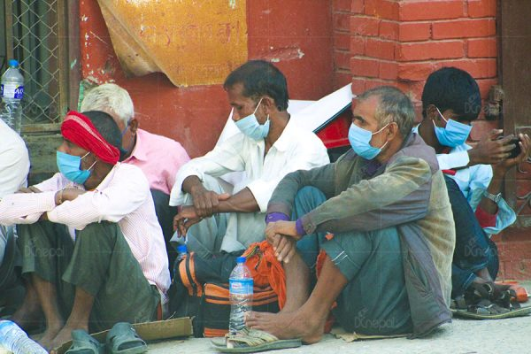 Indian citizens queuing up at Teku hospital for PCR test