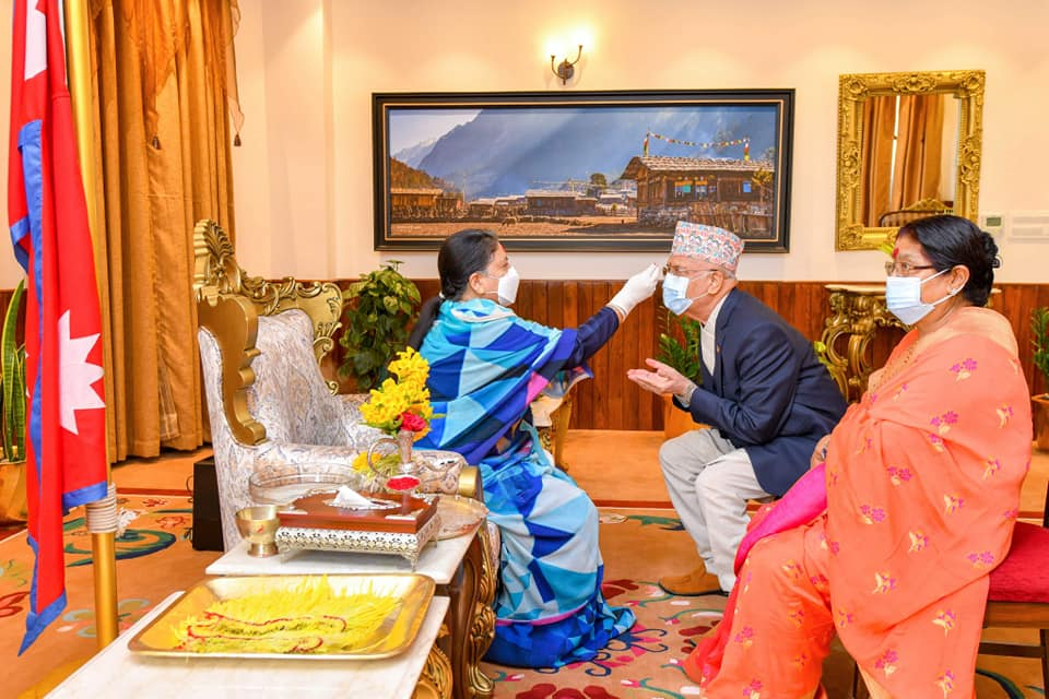 Prime Minister Oli and his wife receive tika from President Bhandari