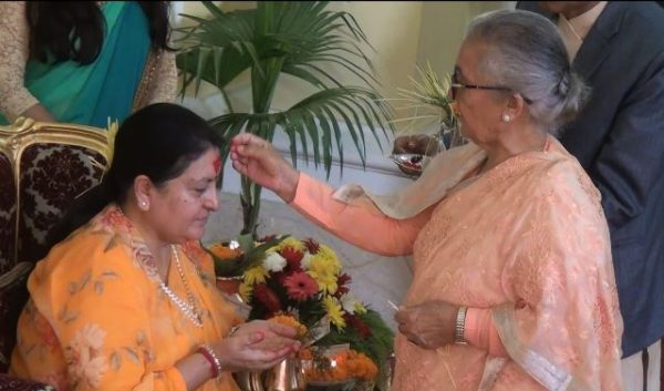 President Bhandari receives Dashain tika from her mother