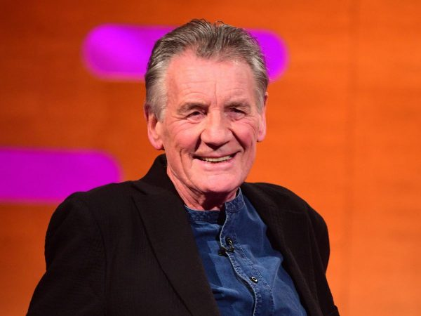Actor Michael Palin joins AI call for UK to urgently redistribute COVID-19 doses